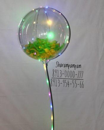 Светящийся шар с перьями на палочке